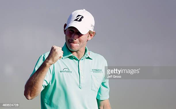 Brandt Snedeker celebrates on the 18th green after his threestroke victory at the ATT Pebble Beach National ProAm at the Pebble Beach Golf Links on...
