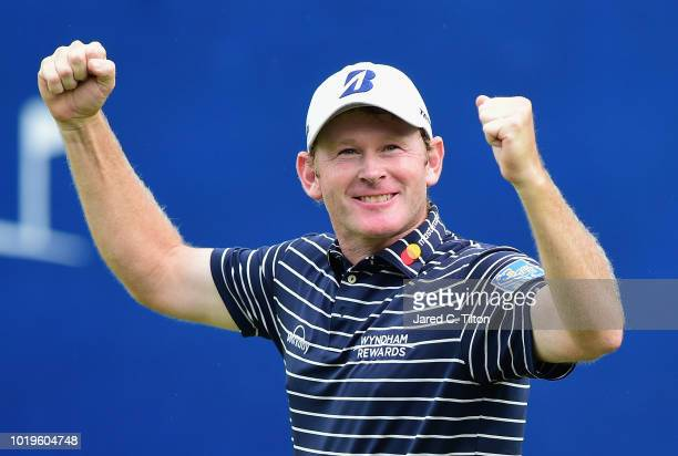 Brandt Snedeker celebrates on the 18th green after making his birdie putt during the final round to win the Wyndham Championship at Sedgefield...