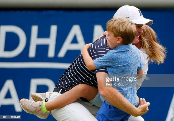 Brandt Snedeker celebrates with his children Austin and Lily on the 18th green after making his birdie putt during the final round to win the Wyndham...