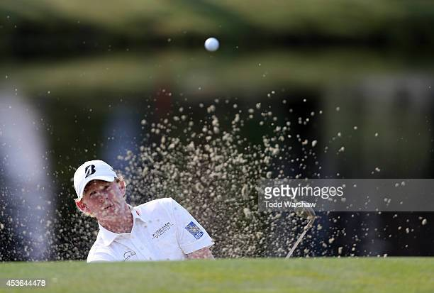 Brandt Snedeker chips out of the bunker on the 15th hole during the second round of the Wyndham Championship at Sedgefield Country Club on August 15,...