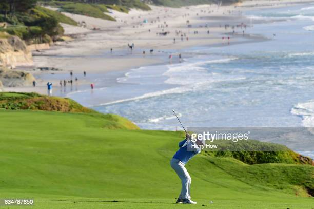 Brandt Snedeker hits his second shot on the ninth hole during Round Three of the ATT Pebble Beach ProAm at Pebble Beach Golf Links on February 11...