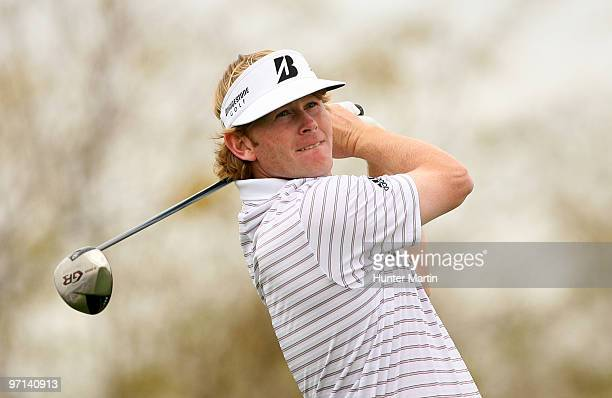 Brandt Snedeker hits his tee shot on the ninth hole during the third round of the Waste Management Phoenix Open at TPC Scottsdale on February 27,...