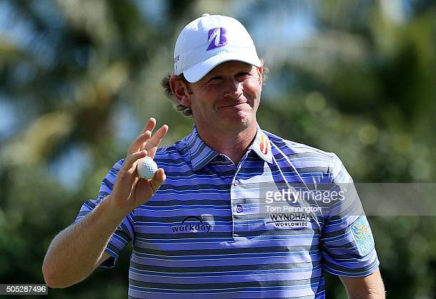 Brandt Snedeker holds up his ball after putting on the third green during the third round of the Sony Open In Hawaii at Waialae Country Club on...