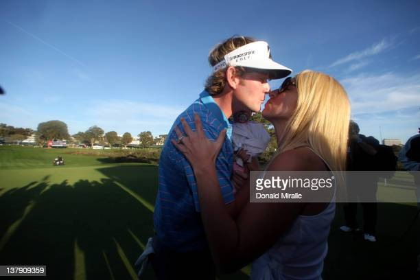 Brandt Snedeker is congratulated by wife Mandy and 11-month old daughter Lily after his -16 under 2 hole playoff victory during the final round of...
