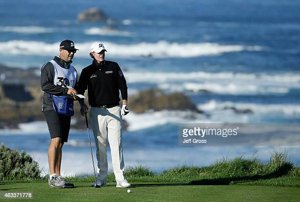 Brandt Snedeker lines up a shot with his caddie Scott Vail on the fourth hole during the second round of the AT&T Pebble Beach National Pro-Am at the...