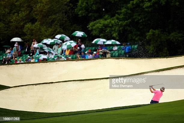 Brandt Snedeker of the United States hits out of the bunker on the fifth hole during the final round of the 2013 Masters Tournament at Augusta...