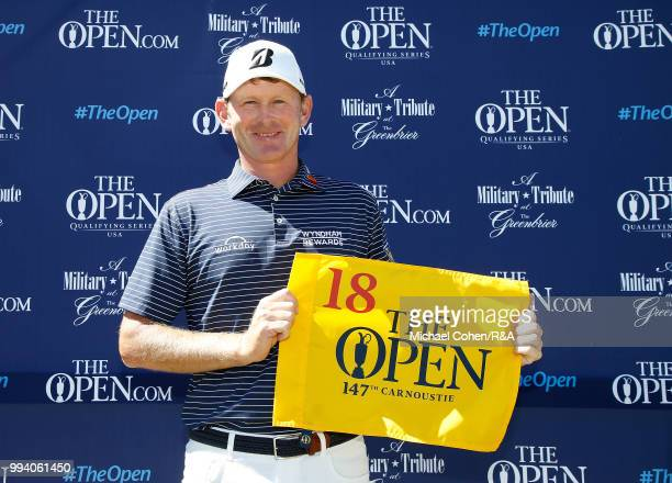 Brandt Snedeker of the United States holds a hole flag after qualifying for the Open Championship during the fourth and final round of A Military...