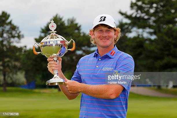 Brandt Snedeker of the United States holds the championship trophy after winning the RBC Canadian Open at Glen Abby Golf Club on July 28 2013 in...