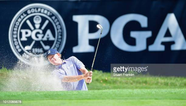 Brandt Snedeker of the United States plays a shot from a bunker during a practice round prior to the 2018 PGA Championship at Bellerive Country Club...