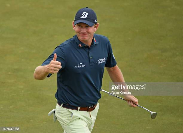 Brandt Snedeker of the United States reacts after making a birdie on the 15th green during the third round of the 2017 US Open at Erin Hills on June...