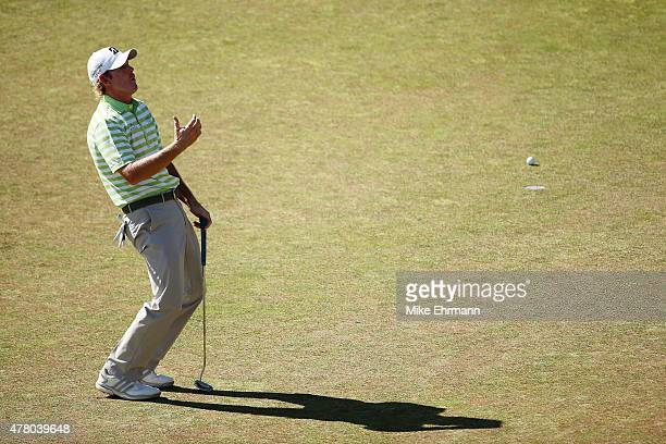 Brandt Snedeker of the United States reacts to a missed putt on the 12th green during the final round of the 115th U.S. Open Championship at Chambers...