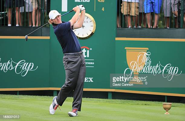 Brandt Snedeker of the US Team hits the first shot of the Day One FourBall Matches on the first tee at the Muirfield Village Golf Club on October 3...