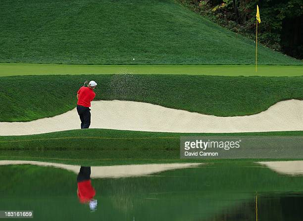 Brandt Snedeker of the US Team plays a bunker shot on the 12th hole during the Day Three Fourball Matches at the Muirfield Village Golf Club on...