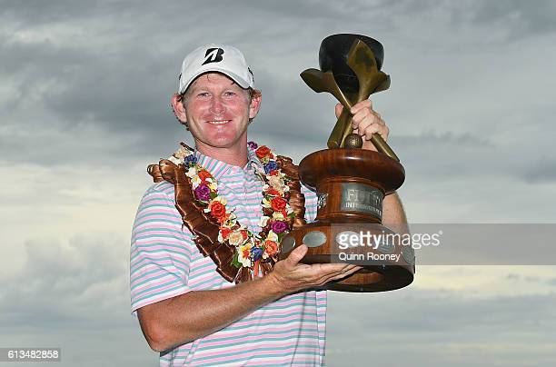 Brandt Snedeker of the USA poses with his trophy after winning on day four of the 2016 Fiji International at Natadola Bay Golf Course on October 9...
