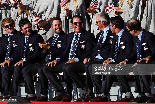 Brandt Snedeker Patrick Reed JB Holmes Phil Mickelson Matt Kuchar Brooks Koepka and Zach Johnson of the United States react on stage during the 2016...