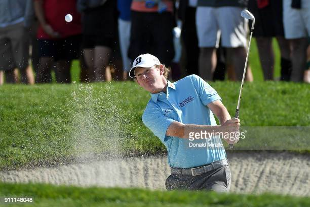 Brandt Snedeker plays a shot from a bunker on the first hole during the third round of the Farmers Insurance Open at Torrey Pines South on January...
