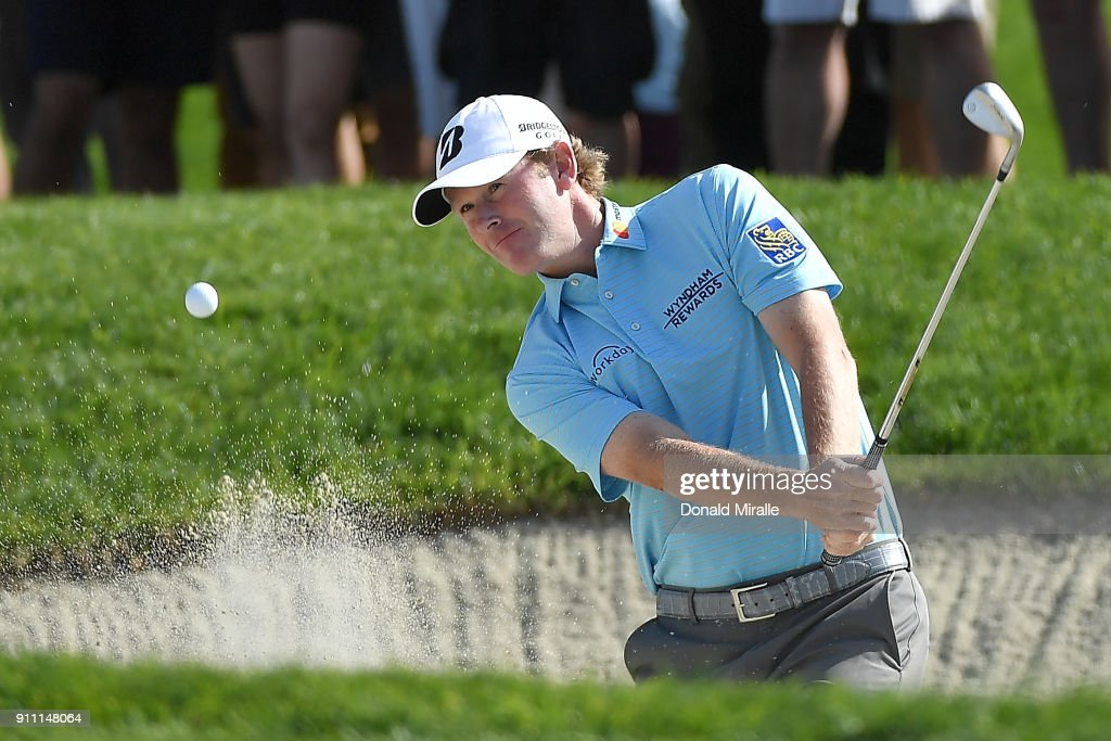 Brandt Snedeker plays a shot from a bunker on the first hole during the third round of the Farmers Insurance Open at Torrey Pines South on January 27, 2018 in San Diego, California.