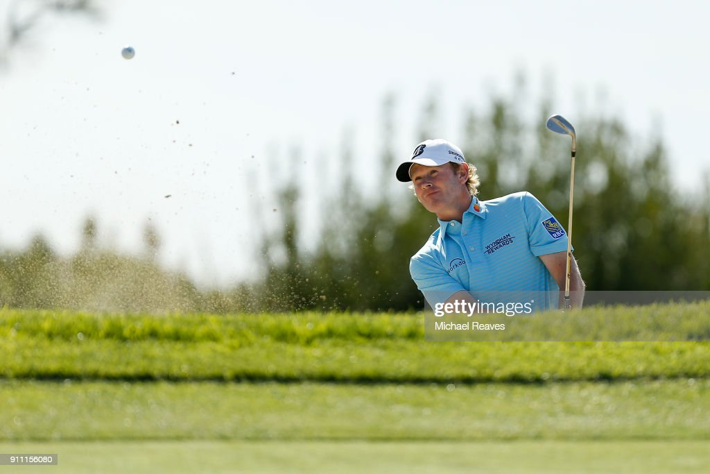 Brandt Snedeker plays a shot from a bunker on the fourth hole during the third round of the Farmers Insurance Open at Torrey Pines South on January 27, 2018 in San Diego, California.