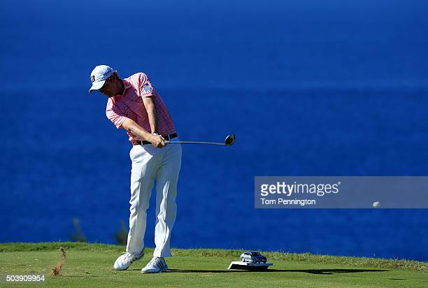 Brandt Snedeker plays his shot from the 13th tee during round one of the Hyundai Tournament of Champions at the Plantation Course at Kapalua Golf...