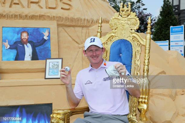 Brandt Snedeker poses with the ball and glove that he shot 59 with during the first round of the Wyndham Championship at Sedgefield Country Club on...