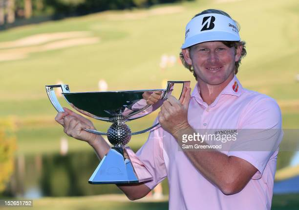Brandt Snedeker poses with the FedExCup after after his three stroke victory at the TOUR Championship clinched the cup during the final round of the...