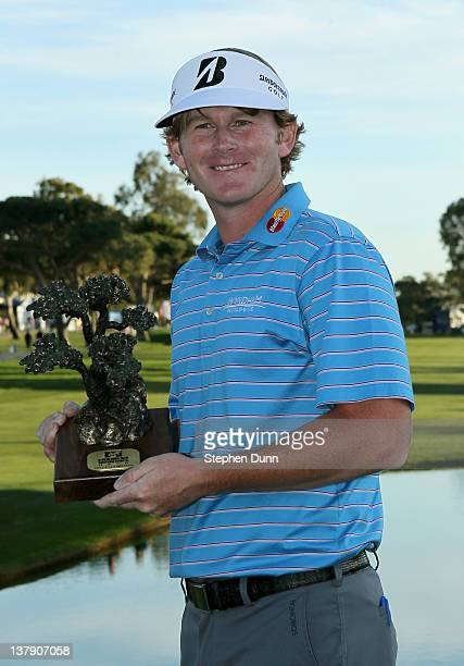 Brandt Snedeker poses with the trophy after the final round of the Farmers Insurance Open on the South Course of the Torrey Pines Golf Course on...
