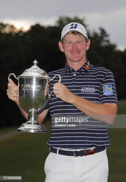 Brandt Snedeker poses with the trophy after winning the Wyndham Championship at Sedgefield Country Club on August 19, 2018 in Greensboro, North...