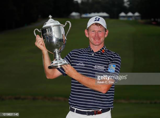 Brandt Snedeker poses with the trophy after winning the Wyndham Championship at Sedgefield Country Club on August 19 2018 in Greensboro North Carolina
