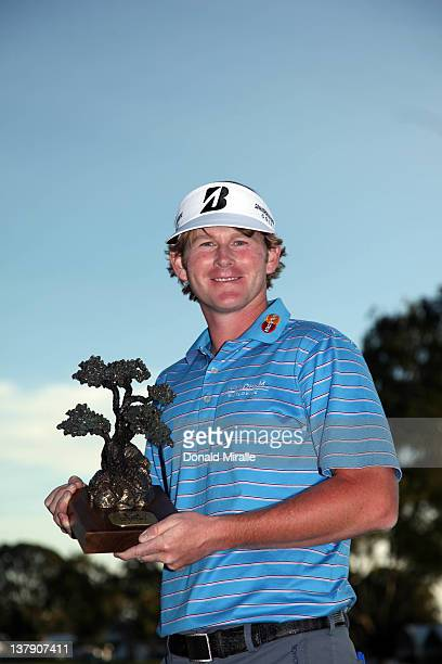 Brandt Snedeker poses with the winner's trophy after his 16 under 2 hole playoff victory during the final round of the Farmers Insurance Open at...