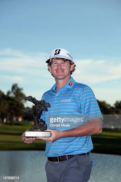 Brandt Snedeker poses with the winner's trophy after his -16 under 2 hole playoff victory during the final round of the Farmers Insurance Open at...