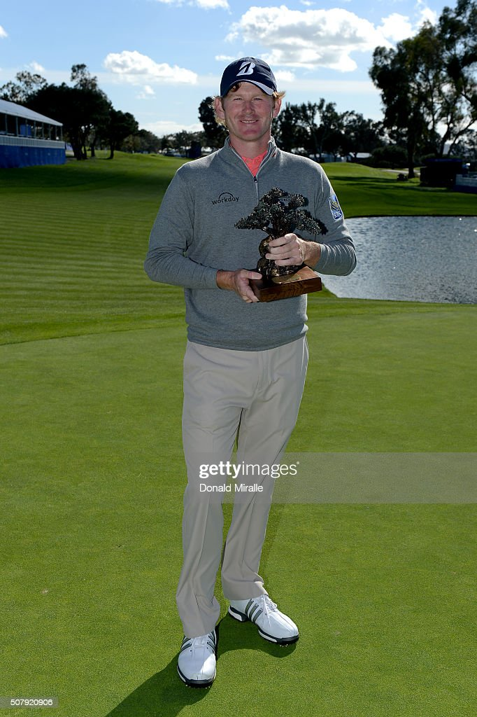 Brandt Snedeker poses with the winner's trophy after winning the Farmers Insurance Open at Torrey Pines South on February 1, 2016 in San Diego, California. Play was suspended due to inclement weather on Sunday.