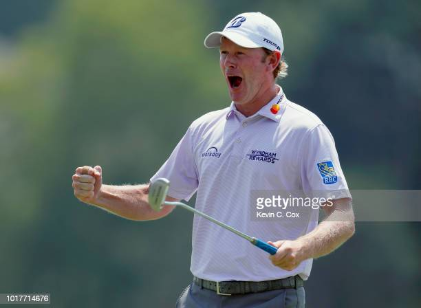 Brandt Snedeker reacts following a birdie putt on the ninth hole during the first round of the Wyndham Championship at Sedgefield Country Club on...
