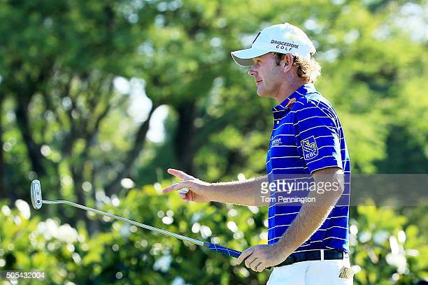 Brandt Snedeker reacts to his birdie putt on the 14th green during the final round of the Sony Open In Hawaii at Waialae Country Club on January 17...