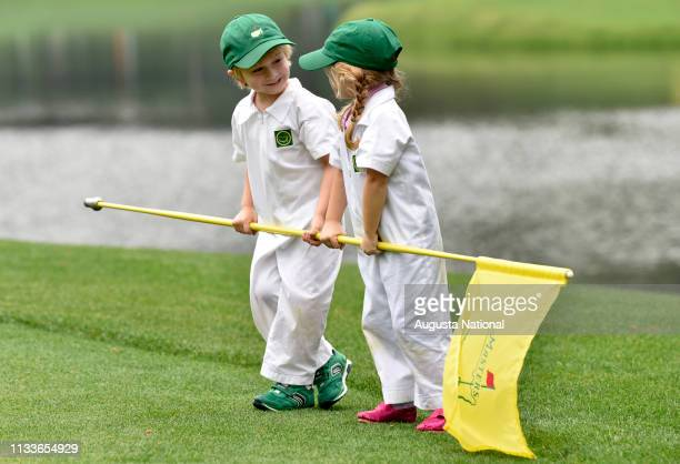 Brandt Snedeker's son Austin and Charley Hoffman's daughter Claire play during the Par 3 Contest at Augusta National Golf Club, Wednesday, April 5,...