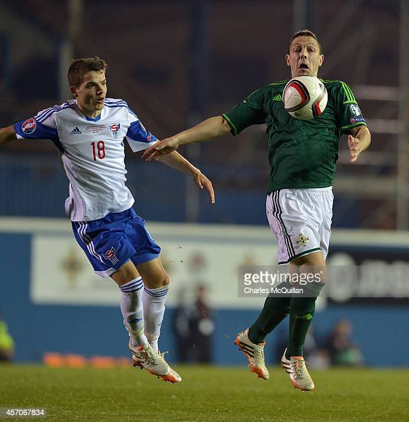 Brandur Olsen and Chris Baird during the Euro 2016 Qualifier between Northern Ireland and Faroe Islands at Windsor Park on October 11 2014 in Belfast...