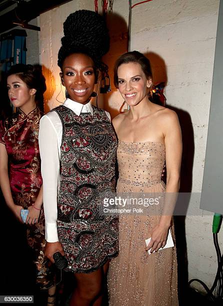 Brandy and Hilary Swank pose backstage during the 21st Annual Huading Global Film Awards at The Theatre at Ace Hotel on December 15 2016 in Los...