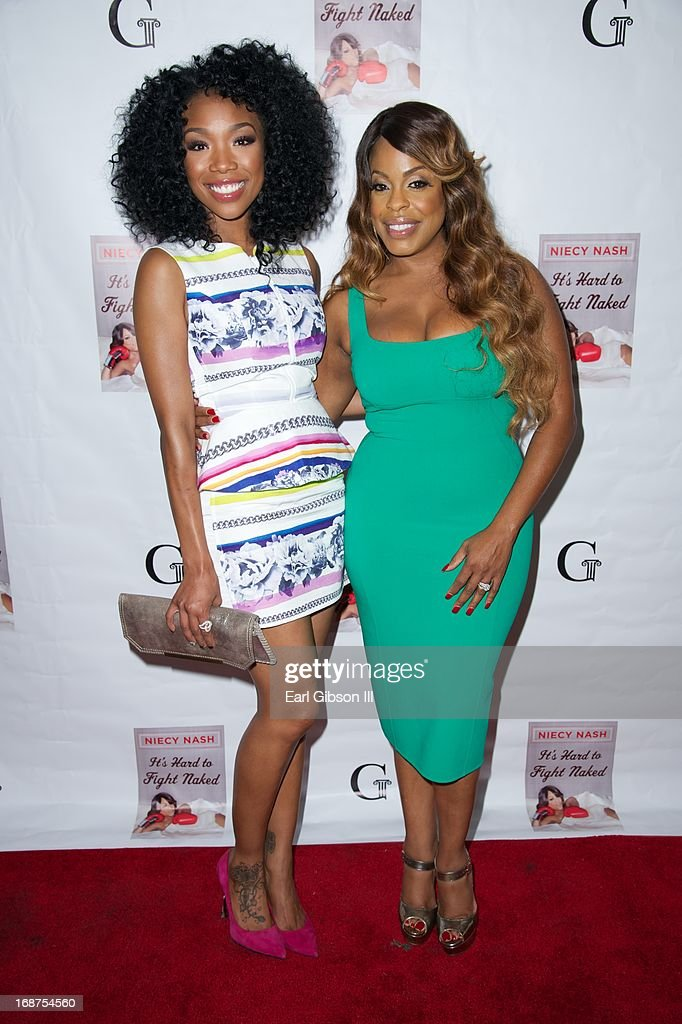 Brandy and Niecy Nash celebrate the release of 'It's Hard to Fight Naked' by Niecy Nash at Luxe Rodeo Drive Hotel on May 14, 2013 in Beverly Hills, California.