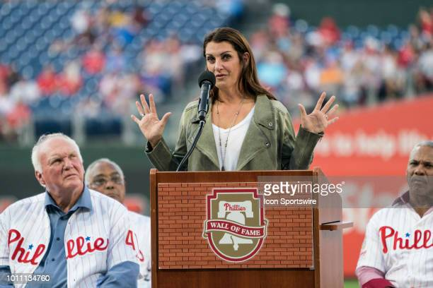 Brandy Halladay makes an acceptance speech into the Philadelphia Phillies Wall of Fame for her deceased husband Roy Halladay prior to a MLB game...