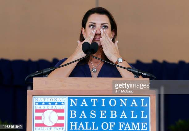 Brandy Halladay speaks on behalf of her late husband Roy Halladay during the Baseball Hall of Fame induction ceremony at Clark Sports Center on July...