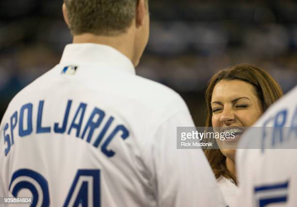 Brandy Halladay wife of the late Roy Doc Halladay enjoys a laugh with some of his former teammates Toronto Blue Jays Vs New York Yankees in MLB Home...