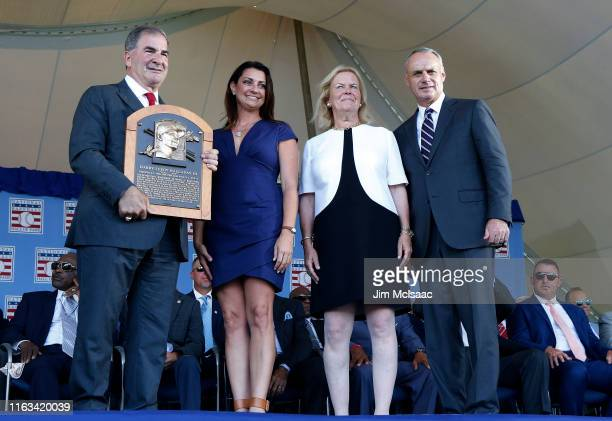 Brandy Halladay wife of the late Roy Halladay poses for a photograph with his plaque alongside Hall of Fame president Tim Mead Chairman of the board...