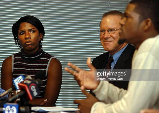 Brandy Hawk of Burlington New Jersey listens as her attorney Sid Gold and Jeffrey Campbell a former security supervisor at Abercrombie Fitch and...