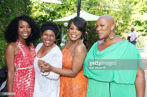 Brandy Jenifer Lewis Niecy Nash and Frenchie Davis pose for a photo at Niecy Nash's One Year Wedding Anniversary Celebration on May 27 2012 in...