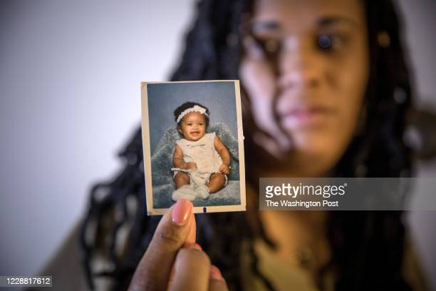 Brandy Johnson Billie holds a photograph of her daughter, Ashanti, a 19-year-old college student, who disappeared going to work. Ashanti was later...
