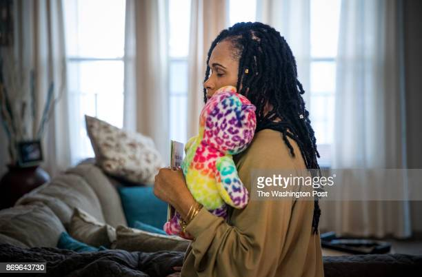 Brandy Johnson Billie, holds one of her daughter Ashanti's favorite teddy bears, in her apartment in Oxon Hill, Maryland. Ashanti, a 19-year-old...