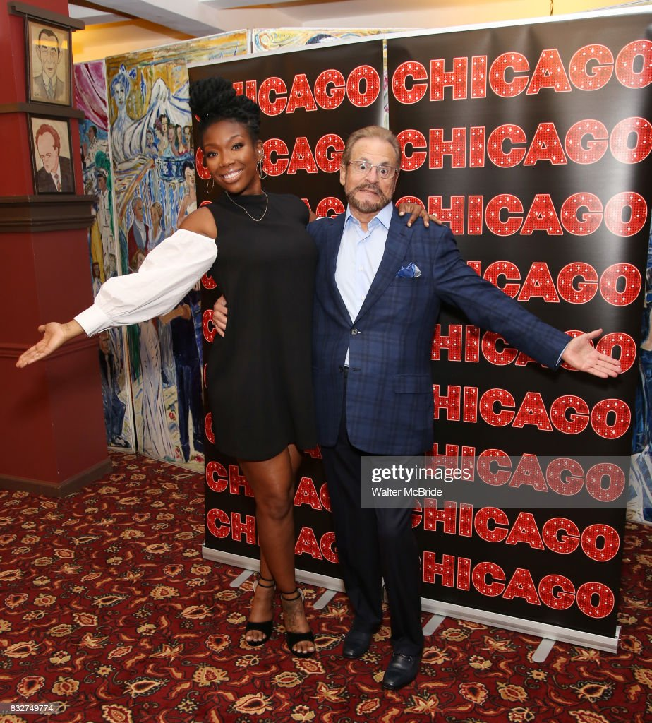 Brandy Norwood and Producer Barry Weissler attend the press photo call for her return to Broadway's 'Chicago' at Sardi's on August 16, 2017 in New York City.