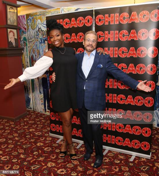 Brandy Norwood and Producer Barry Weissler attend the press photo call for her return to Broadway's 'Chicago' at Sardi's on August 16 2017 in New...