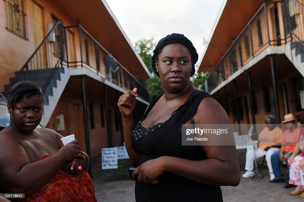 Brandy Young stands near her apartment before officials arrived to empty her apartment and change the locks during an eviction on June 15, 2010 in Miami, Florida. A small protest organized by Take Back the Land tried to prevent the eviction but it was unsuccessful. According to the activists, the bank, which now owns the apartment complex, is forcing the current residents out and they have no other homes to move to.