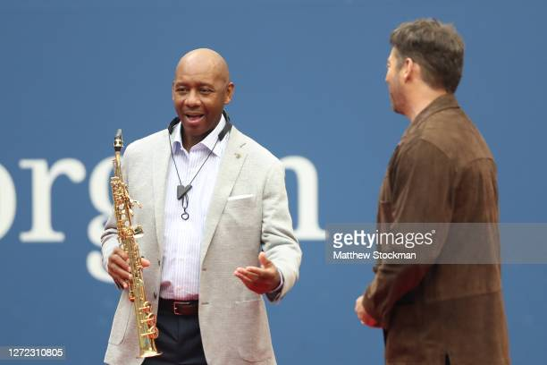 """Branford Marsalis and Harry Connick, Jr. Talk before performing """"America the Beautiful"""" before the Men's Singles final match on Day Fourteen of the..."""