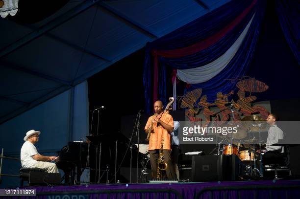 Branford Marsalis performs with his father Ellis and his brother Jason at the New Orleans Jazz and Heritage Festival at the Fair Grounds Race Course...